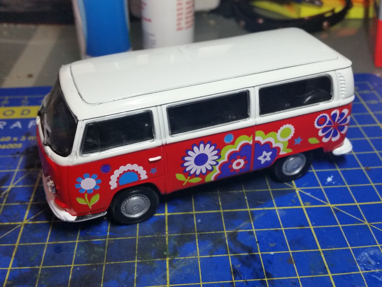 I picked up this 1:55 scale die cast VW van for €3,- as a starting point.