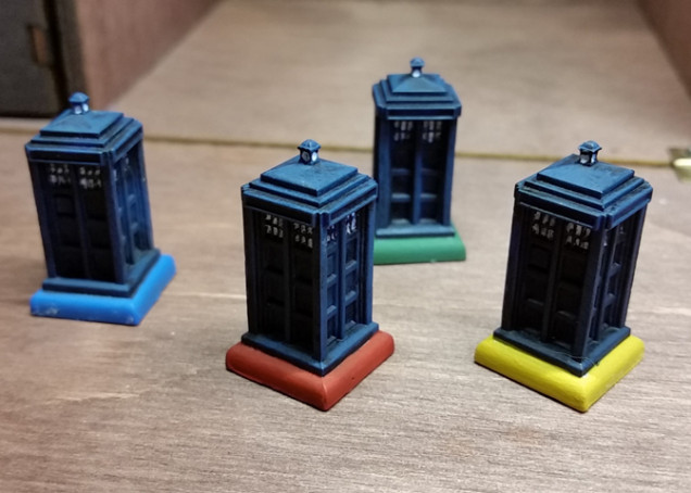 Simple black primer, then blue drybrush. I wasn't originally going to do the windows because they're so small, but I finally relented. I don't think they look great, but good enough for a board game.