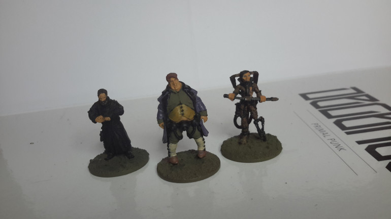 From left to right, either an encounter figure or a proxy for a Chronicler, A fat dude, Aspera (the only official 28mm figure by Freebooter) I need to finish base coats followed by wash and highlights.