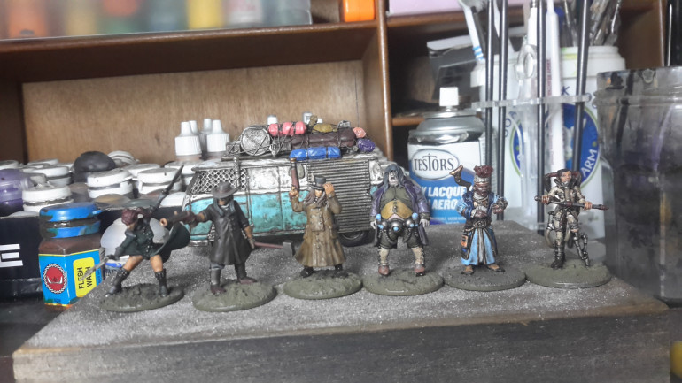 First group of figures now have all Base colours and metallic done, I then highlighted the black, followed by giving the whole miniature a wash of GW Agrax Earthshade. (I find that by giving a wash over the highlighted black it help tone down highlights)