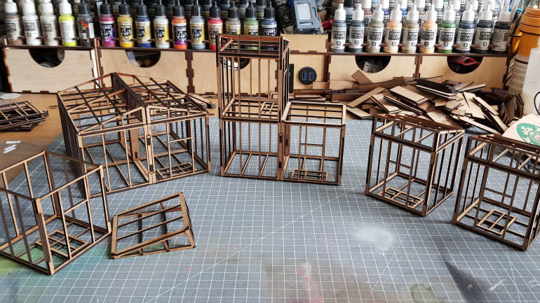 The building selection I have made so far. You can see my huge pile of scrap MDF in the background.