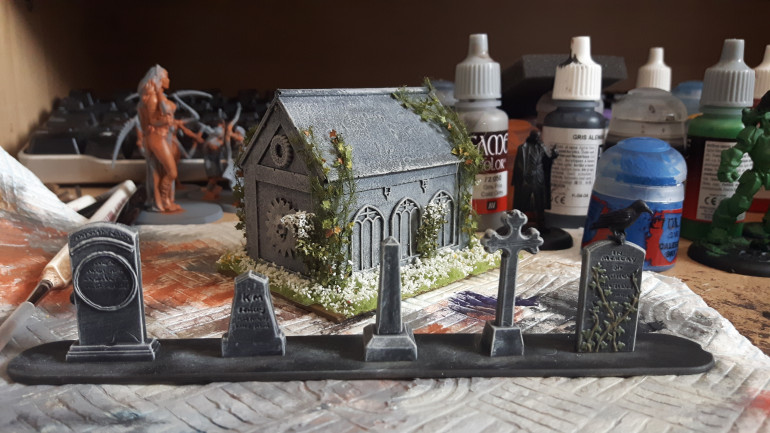Here's a mausoleum my other half painted.  The mausoleum is from Templar Wargames.  I've tried to make the gravestones look as similar to the mausoleum as I can.