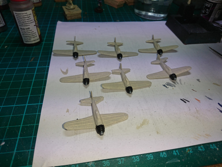 The prep and base coat of the zeros is done using Vallejo Deck Tan