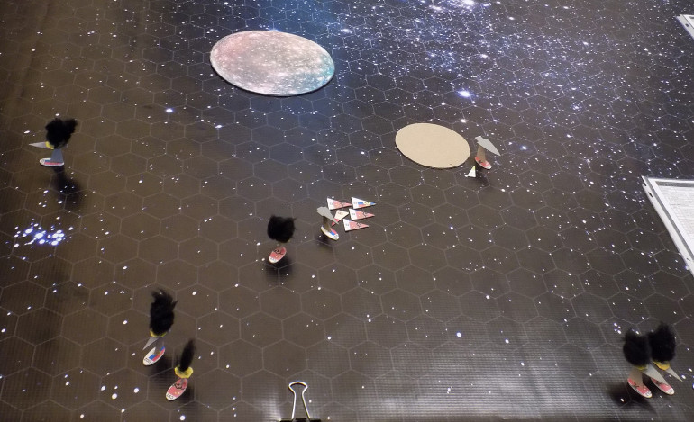 The dogfight begins between the Xin Tian and the Syekyra.  The Xin Jian is currently using the smaller Chernyeva Twelve moonlet to cover her damaged fantail.
