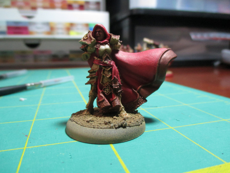At the end of the session I had washed the bleached armor while layering it back up with the Zandri Dust.  I washed the gold details and am generally happy with how the wash came out.  The layering on the red cloth and cloak has been completed.  My next steps are to paint the armor trim and highlight the cloth and gold details.