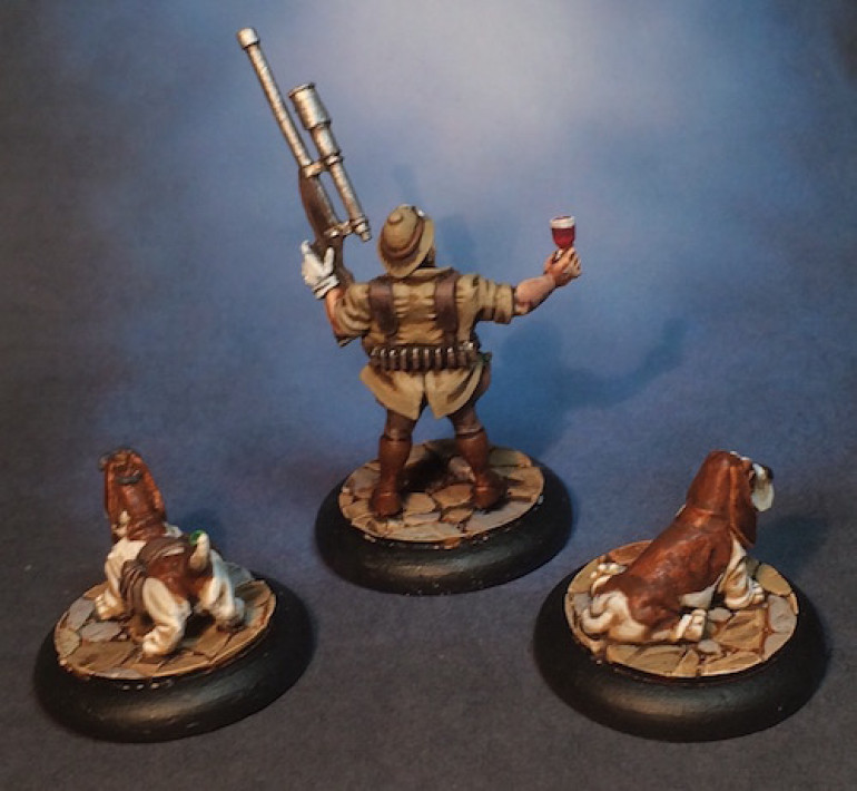 I am rather pleased with how this little group came out.  To be honest, I want more of the hound miniatures for other projects I have in mind.