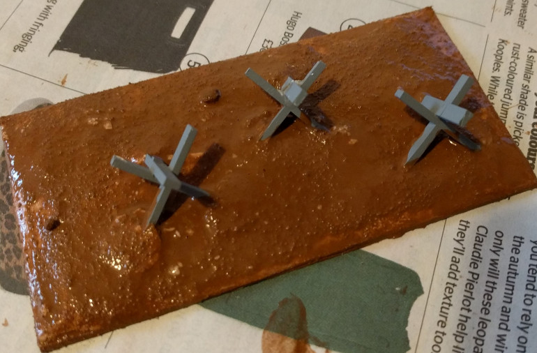 Tank traps with the wash going down - I've deliberately used a lot of wash here