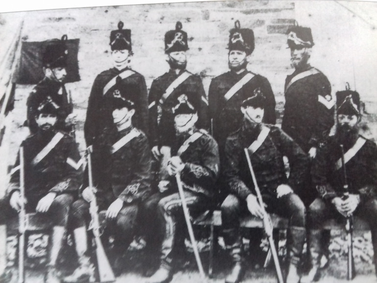 Unusual picture of the Hussars with busbie hats painted on to the picture which they never wore