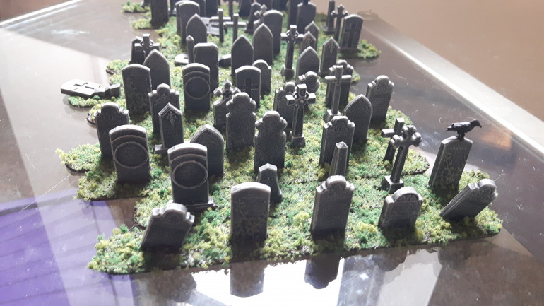 Here we have the flock attached. I started by sprinkling the dark tone around the gravestones. I then sprinkled some mid tone and finally a tiny dash of bright tone. This was to try and give some semblance of depth.