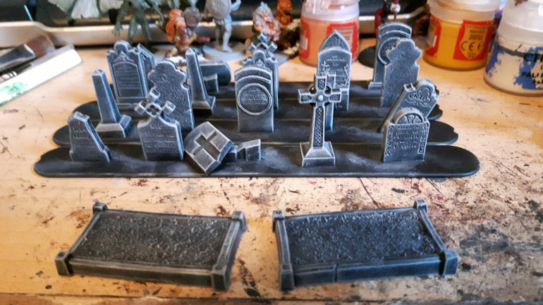 I've finished painting the last of the gravestones. Just need to paint the creepers on one of them.