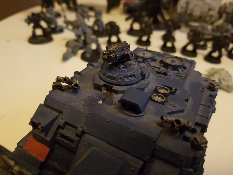 Having looked through the full gallery on the web store for this tank, it apperas the bits on top are optional extras, and this gun turret is just as valid.  Thres 2 painted up, and 2 tanks with then snapped off of so the previous owner must have been using this part.  I'm calling this tank comp;lete, unless anyone sees anything else?