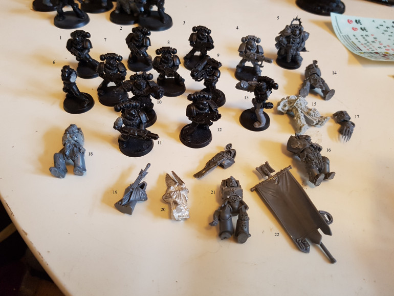 The Marines already on bases or that caught my eye.  I see some characters and a beaky marine.  Anyone recognise anything?