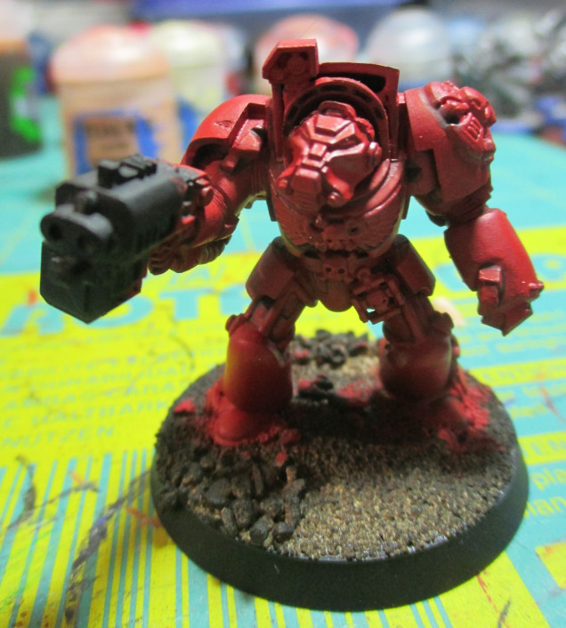 The touch up of Mephiston Red just helps with the definition of the miniature.