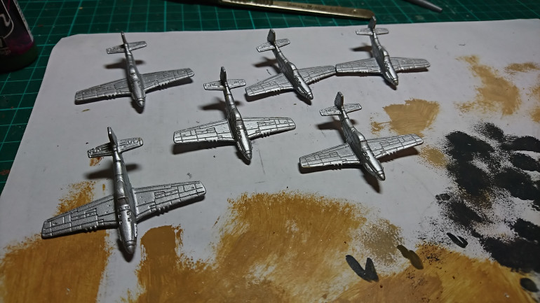 First up using Vallejo Model Air Aluminium to base coat all the planes.