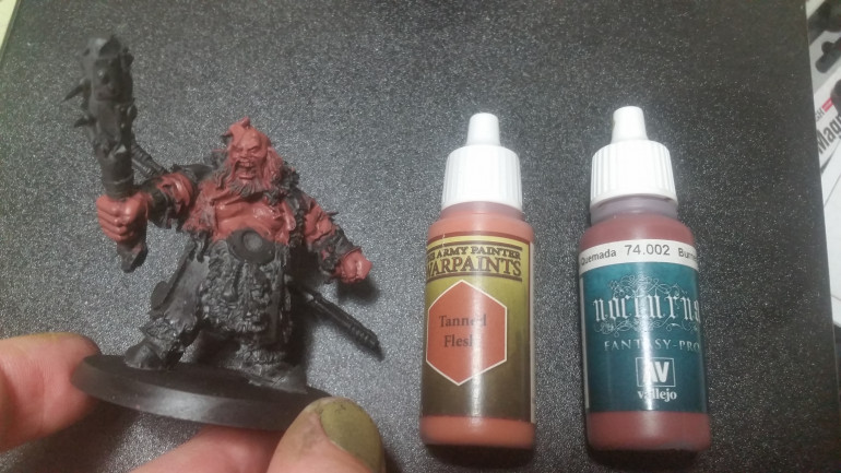 It's a little unclear, but these two paints were mixed roughly 1 to 1.