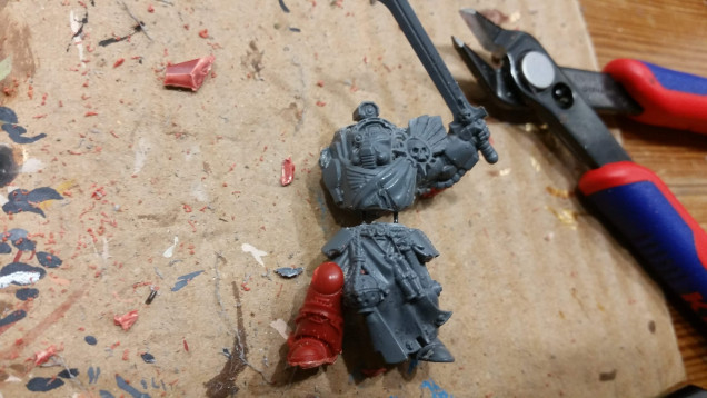 The Picnic Terminators leg is being fitted into place on the sergeant.