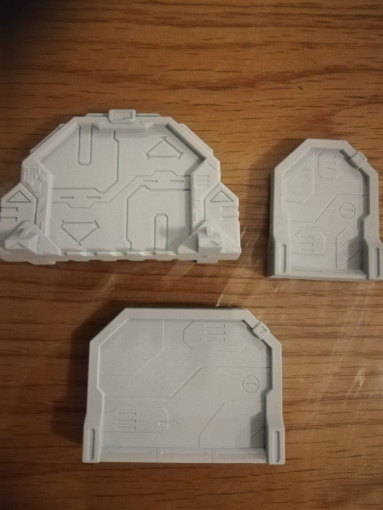 In the sedition wars box you get 3 types of doors which I have primed white.