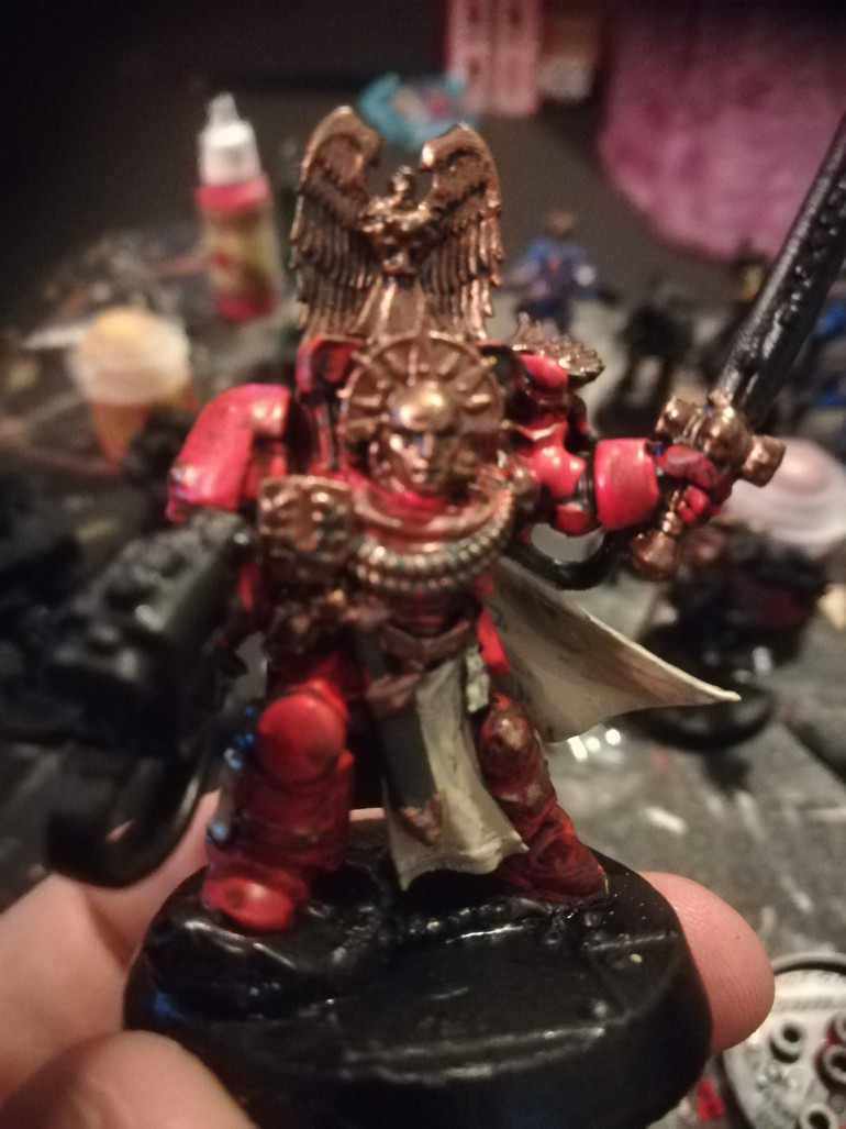 WIP of my captain the models came with no helmets but the fluff of the space hulk rules say that the space hulk as no atmosphere so I swapped out the heads and added some extras from my bits box.