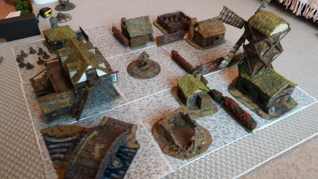 So an initial layout, I might yet replace the ruin and the building next to it with a Blacksmiths/ bakery building.