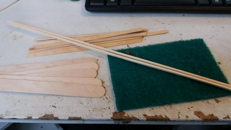Basic ingredients, tongue depressors, coffe stirrers, scouring pads and square bamboo rod