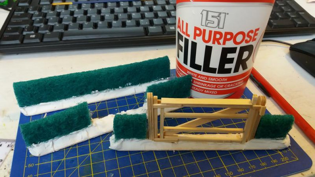add some filler to make the ground, I use poundshop pre mixed stuff, cheap and cheerless...