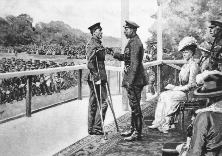 receiving his VC from King George V