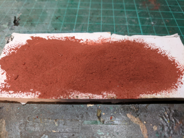 When applied in thick layers the iron powder and weathering powders build up a rough texture and when dry the paint has a slightly powdery look.