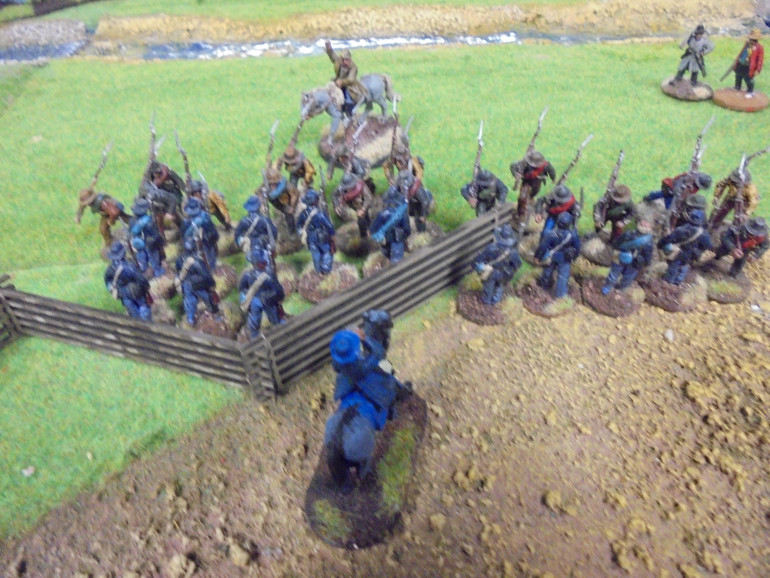No longer fearing enfilading fire the Confederates surge forward and send Marshall's men into a rout, the Skirmishers were particularly agile this game.