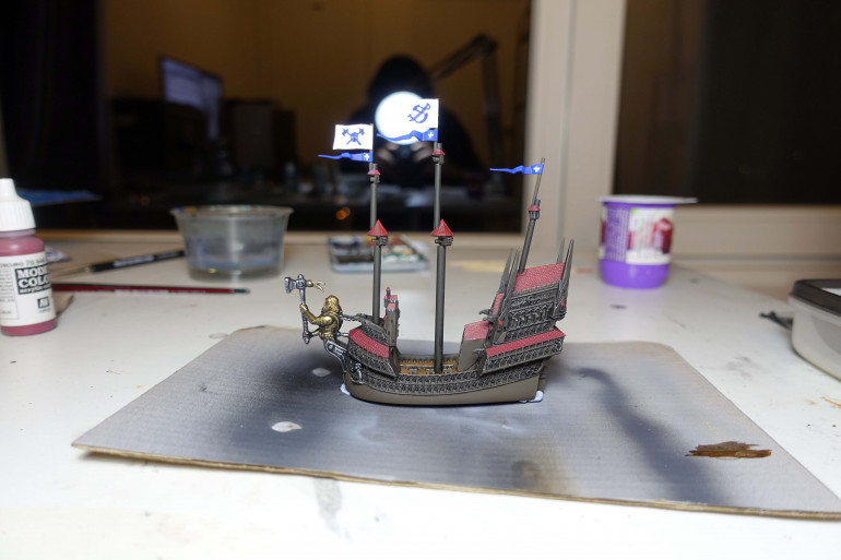 I did paint all the cannons black. Those on the deck as well as those sticking out of the beam and stern.