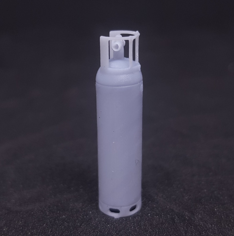 Another view of the printed bottle including the hole for the 1mm pipe which surprisingly printed.