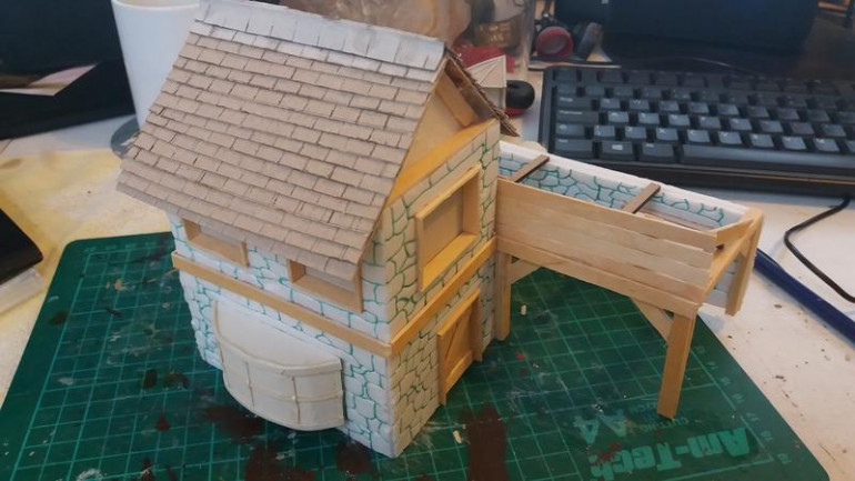 So the roof is done, in the same way as the well, but without the rounding provided by the nail clippers