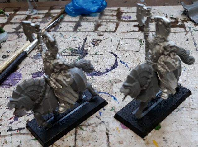 ...and a couple mounted. regrettably their left arms are lost to history, so some conversion work would be necessary.