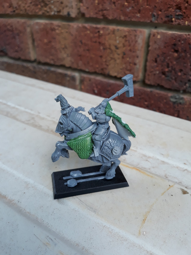 Grandmaster of the White Wolf last week with the first round of greenstuff and parts conversion...