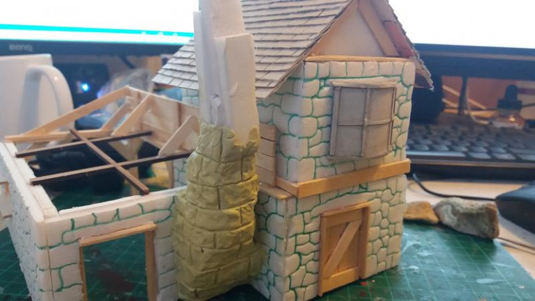 And onto the chimney, instead of the daub effect for other chimneies in the set, Ive gone for a rickerty stone effect, The form is off cuts of foam board and a milliput skin again textured with a real stone and carved with a sculpting tool.