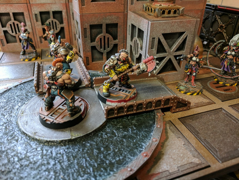 I like scenery which limits movement or provides obstacles to traverse, looks like these Goliath gangers have fallen into an Escher ambush.... Time to sink or swim.