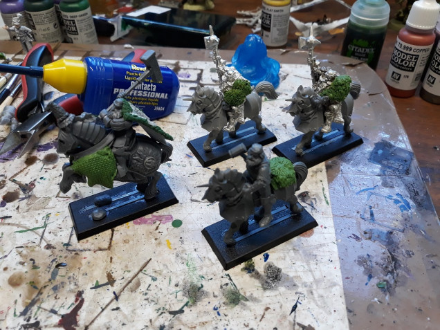 The crew from today. Grandmaster still needs more work but happy with the extra bulk on the horse. Thinking of adding fur blankets on the rea to make it look halfway to chaos (hey - it's a big hammer wielding hairy guy from the north...)