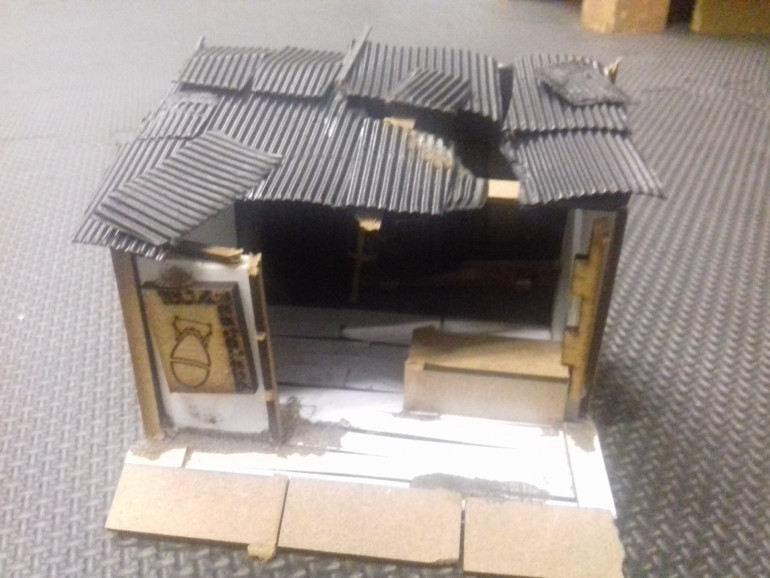 My first scratch built piece building for Fallout. I thought a traders stand would be easy to do. It was a simple construction made from foam board and various off cuts from MDF kits just plasted on it.