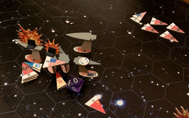 Okay, here's the Turn 5 smackdown.  USS Princeton shoots down one Black Dragon bomber (despite sensor damage and range penalties), that two less aerospace torpedoes coming at me this turn.  The rest launch.  These are far more dangerous than the slower Chinese and Russian-built warship torpedoes, so Oriskany and Valley Forge engage them with point-defense mass drivers first.  Almost all are shot down, but several hit, along with some of the warship torpedoes (there are just too many of them, and USS Valley Forge doesn't have the same electronic warfare bonus as the Oriskany does).  That, and elite or not, these are still JUST destroyers, and it doesn't take that much damage to knock one down.  The Valley Forge is crippled!  She's already fired into the stern of the Zhang Jia, however, along with the Oriskany, in a point-blank broadside.  My Marine fighters went in for a gunnery run, followed by by torpedoes, most of which were shot down by mass drivers from the Zhang Jia (supported from the nearby carrier Zharanyeva) and also the remaining Black dragon scout planes.  Meanwhile, my scouts butcher the rest of the Black Dragon bombers (after they released ordinance and helped cripple the Valley Forge, unfortunately).