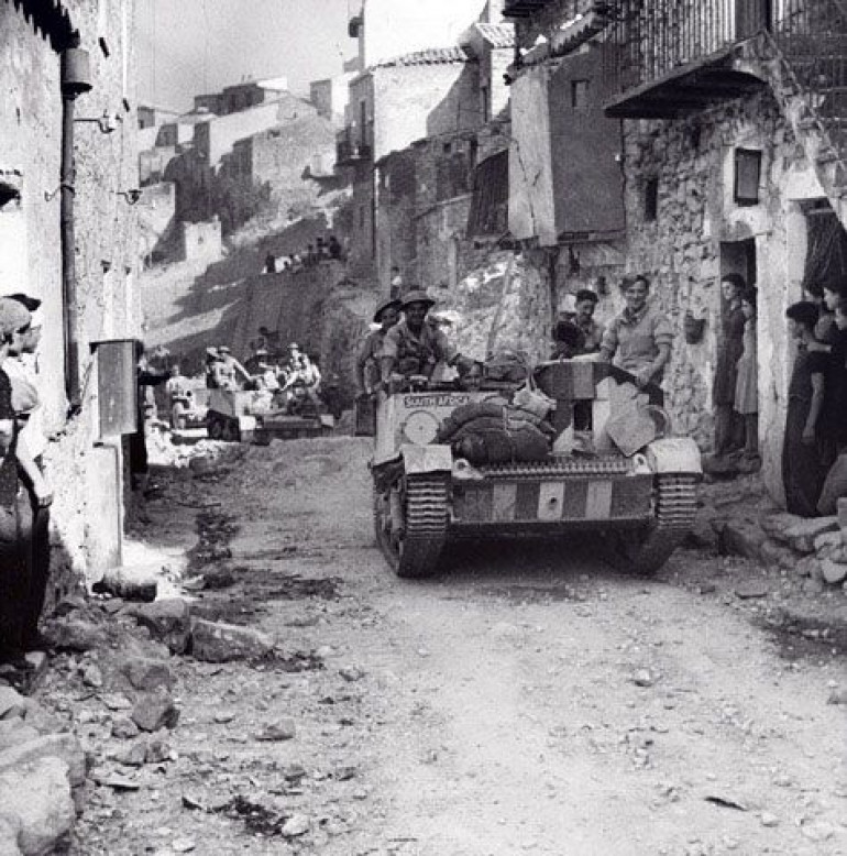 British Bren Carrier advancing through a town in Sicily