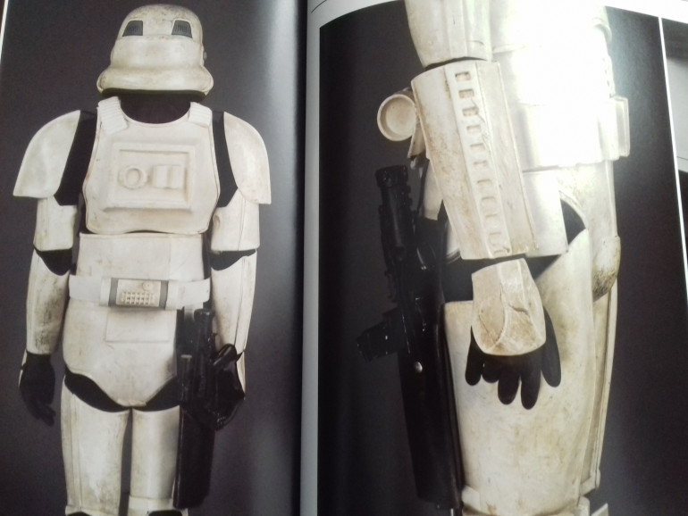 Holstered blaster on worn armour