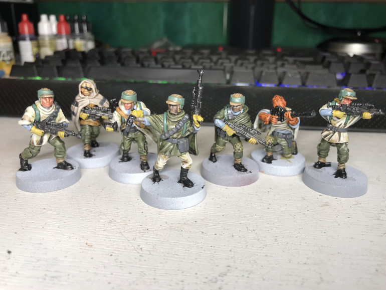 Finally got back to painting, here are the rebels with washes applied