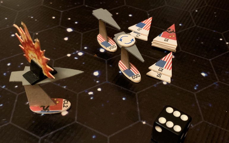 So now the only ships left are the USS Oriskany, and VERY badly damaged USS Princeton, and the empty carrier Zharanyeva.  The Zharanyeva is powering off to the other side of the board to run out the clock for partial victory points, but the scouts are heading in for one last kamikaze effort to hit the unshielded side of the damaged Princeton.  Jenn comes close here, she really does, but the one point of damage that actually gets in just doesn't hit in the right place, and of course all  the scouts are massacred by mass driver point-defense and Marine fighters.  The battle, finally, is over.