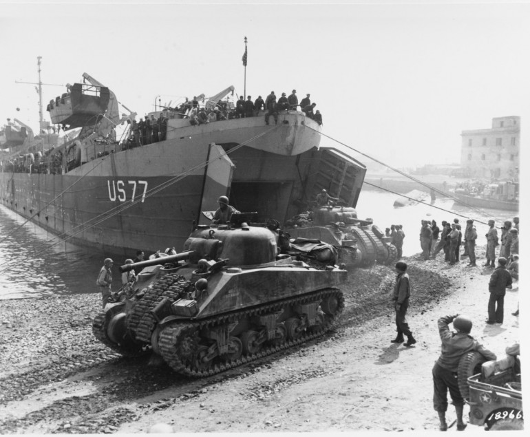 US 1st Armoured Division arriving shortly after the beach head was secured