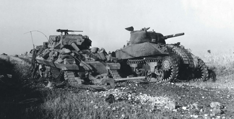 Knocked out M10 and Sherman following the German counter offensive