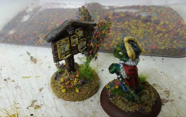 and flocked and added to the sign post. these are too large to add to a minis base but a cm long one would look fine.