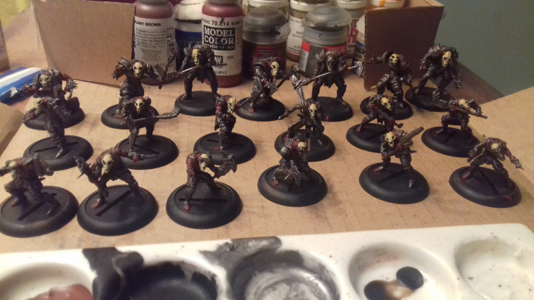 Over last two nights I have added basecoats to the fleshy areas Army Painter Burnt Red, and the skulls and claws Army Painter Iraqui Sand.
