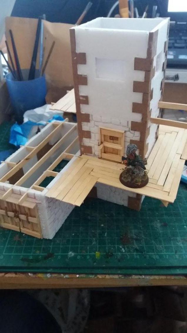 Jump to its sort of assembled and the watch tower is built and a lot of woodwork is in place