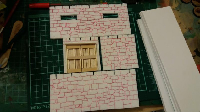 armoury, cut and carved, and the main bulk of the doors are in place.