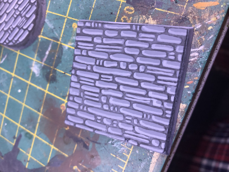 Base with a single broad highlight on the bricks