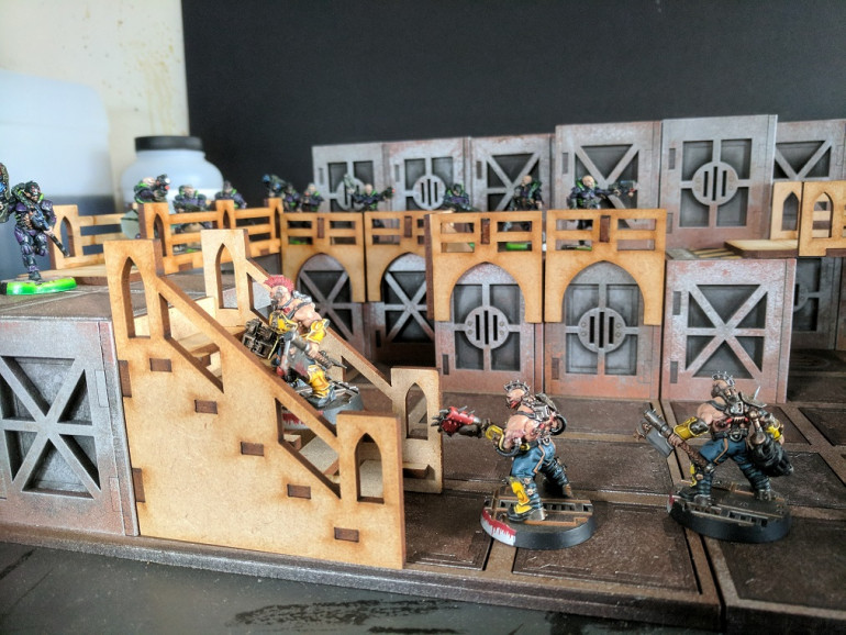 Another nice feature is the stairs are pretty much functional with enough of a flat area and gap to sit miniatures on both size bases.
